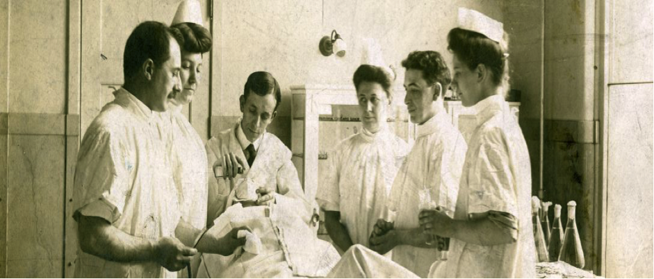 the dentist with the assistants performing a procedure